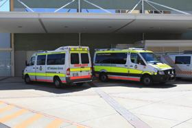 A photo of an ambulance bay at a hospital with two ambulances parked