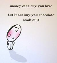 A card that reads: money can't buy you love but it can buy you chocolate, loads of it