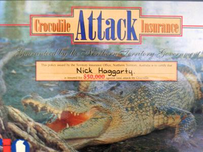 Photo of my laminated crocodile attack insurance certificate.