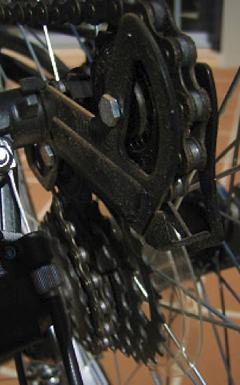 A close up photo of the gears on a bicycle