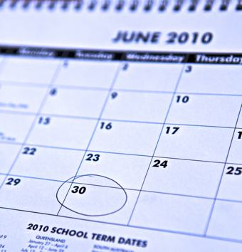 A close up photo of a calendar with the 30 of june circled