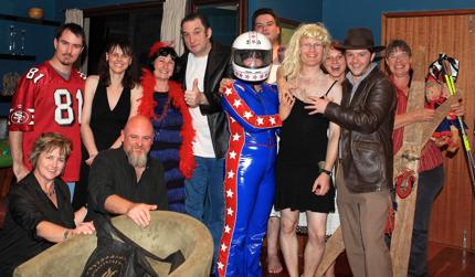 A group shot of myself and Claudia with friends on a poker night. The theme for the evening was fancy dress and those present have gone to some effort to dress as Fonzi, Indianna Jones and even Evel Knievel. I was the only cross-dresser.