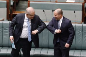 PM Scott Morrison and Treasurer Josh Frydenberg touch elbows instead of shaking hands during COVID-19