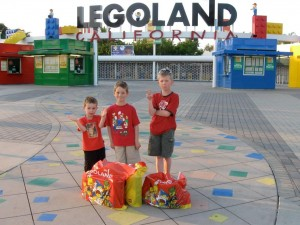 A photo of the three boys standing in front of Legoland California with their recently purchased stash of Lego
