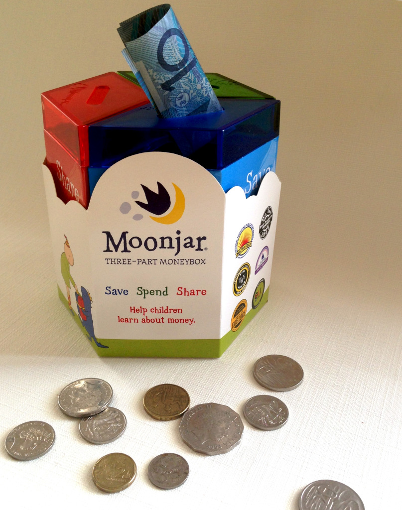 Photo of a Moonjar moneybox showing 3 compartments: one for spending, one for saving and one for sharing.