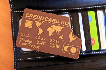 Photo of a credit card made from chocolate, with a bite out of one corner