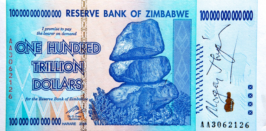 Photo of a Zimbabwean banknote for the amount of one hundred trillion dollars. It has been signed by Zimbabwe Prime Minister Morgan Tsvangirai.