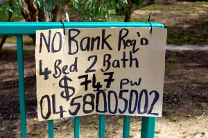 "Photo of a dodgy sign that reads ""No bank req'd. 4 bed 2 bath $747 p w with a mobile number underneath."